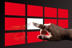 Finger touching  red digital touch screen Stock Photos
