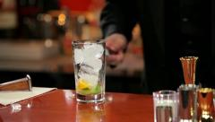 Bartender preparing a cocktail with juice and whiskey (close-up) Stock Footage