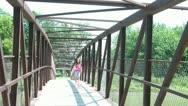 Girl Kicks Ball over Bridge Stock Footage