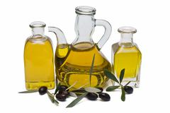 Three bottles with oil. Stock Photos