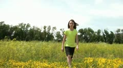 Girl Sits Down in Yellow Flower Field Stock Footage