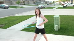 Girl Twirling Hula Hoop Stock Footage