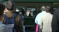 Passengers are waiting to enter a streetcar in Hiroshima, Japan commuting Stock Footage