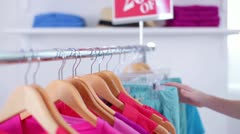 Hand Sorting through Clothes on Store Clothing Rack Stock Footage