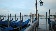 Stock Video Footage of Beautiful Gondolas facing Church of San Giorgio Maggiore, in Venice, Italy