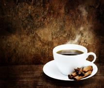 Hot cup of coffee with cinnamon and star anise Stock Photos