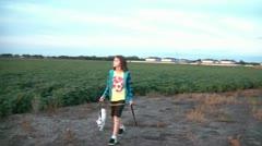 Girl Walking Dog at Sunset Stock Footage