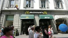 McDonalds with people walking by in Luzern Stock Footage