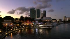 Sunset over Miami skyline and Bayside market on Biscayne bay Stock Footage