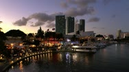 Stock Video Footage of Sunset over Miami skyline and Bayside market on Biscayne bay
