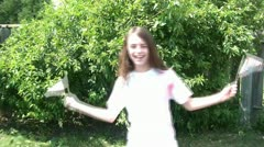 Girl Waving American Flags - 4th of July Stock Footage
