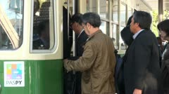 Boarding local streetcar in Hiroshima, public transport in Japan Stock Footage