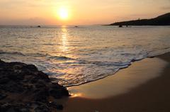 Tropical sunset beach Stock Photos