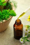 Herbal medicine with dropper bottle Stock Photos