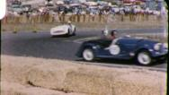 Drivers on Racetrack RACE CARS TAKE CURVE Speed 60s Vintage Film Home Movie 5879 Stock Footage
