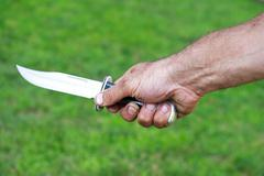 man holding dagger - stock photo