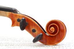 Violin scroll Stock Photos