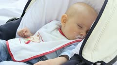 Baby sleeping outdoor in his cart after eating Stock Footage