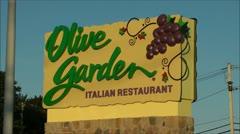 Olive Garden Italian restaurant highway sign Stock Footage