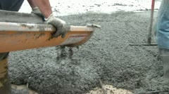 Guiding Concrete Down Chute - Pan up to Truck Stock Footage
