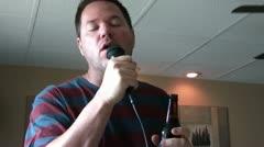 Guy Singing Karaoke Into Microphone Stock Footage