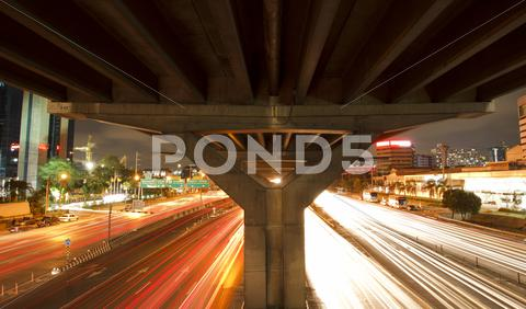 Stock photo of traffic in city at night