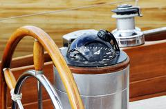 rudder and compass - stock photo