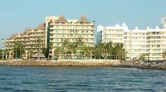 Nuevo Vallarta departing marina by resort hotels on shore HD 4158 Stock Footage