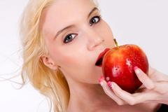 Stock Photo of beautiful blond with apple