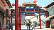Tourists pass Los Angeles Chinatown by day. Stock Footage