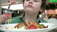 Little boy having lunch at a restaurant Stock Footage