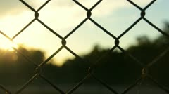 Sunset Through Fence Stock Footage
