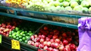 Woman chooses vegetables at the market. Stock Footage