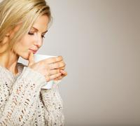 Beautiful woman enjoying the coffee's aroma Stock Photos