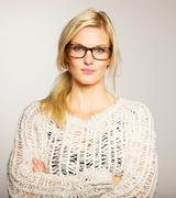 lovely woman wearing glasses looking serious - stock photo