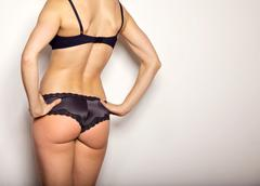 hot woman showing off her back - stock photo