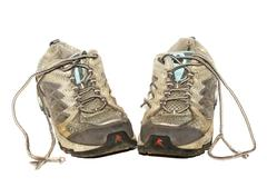 a pair of dirty worn-out jogging shoes - stock photo