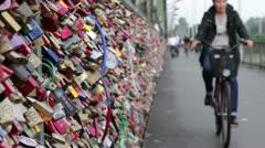 Bikers riding by on locks of love bridge Stock Footage
