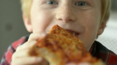 Boy eating pizza - stock footage
