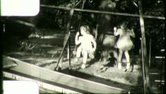Little Girls Swinging Play TWINS Kids SWINGING (Vintage Film Home Movie) 5895 Stock Footage