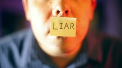 LIAR on mouth not telling truth lying - stock footage