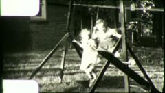 Little Girls Swinging TWINS SWINGING Playground Vintage Film Home Movie 5898 Stock Footage