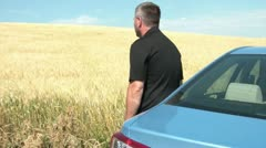 Leaning Against Car & Staring at Wheat Field Stock Footage
