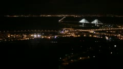 Lisbon aerial night view with Tagus river and bridge Stock Footage