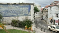 The famous tram 28 in Lisbon and azulejos wall Stock Footage