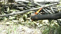 Lighting Fire with Stick in Sunlight Stock Footage