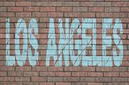 Grunge Los Angeles text painted on brick wall illustration Stock Illustration