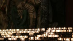 Candles burning at Church prayer station Stock Footage