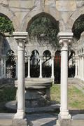 Cloister of 12th century church. - stock photo