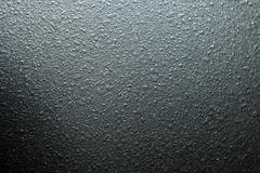 black abrasive surface of the plastic close-up. - stock photo